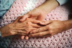 old hand being held by young hands