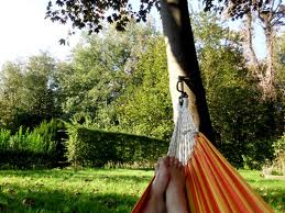 Because this is *totally* my reading nook. A hammock. In my sunny, warm, Irish garden.  Image: thewomancondition.blogspot.com