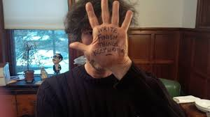 Neil Gaiman with the words 'Write. Finish Things. Keep Writing' written on his hand. Image: redesignrevolution.com