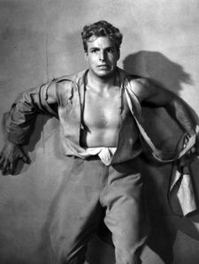 Buster Crabbe as Flash Gordon, promotional still from 1936.  Public domain photo, sourced at flashfriday.wordpress.com